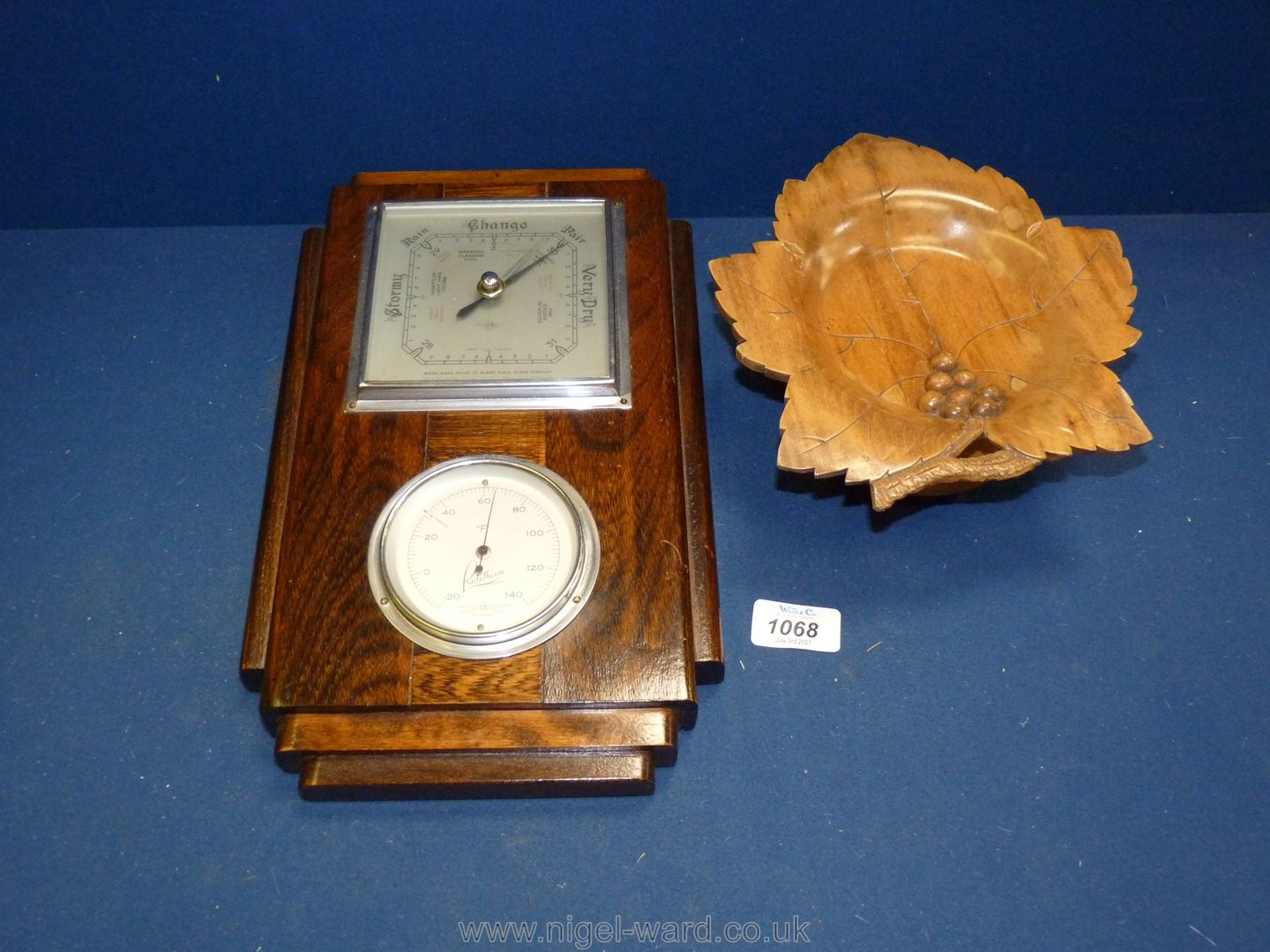A wooden framed wall barometer/thermometer and a treen musical sweet plate.
