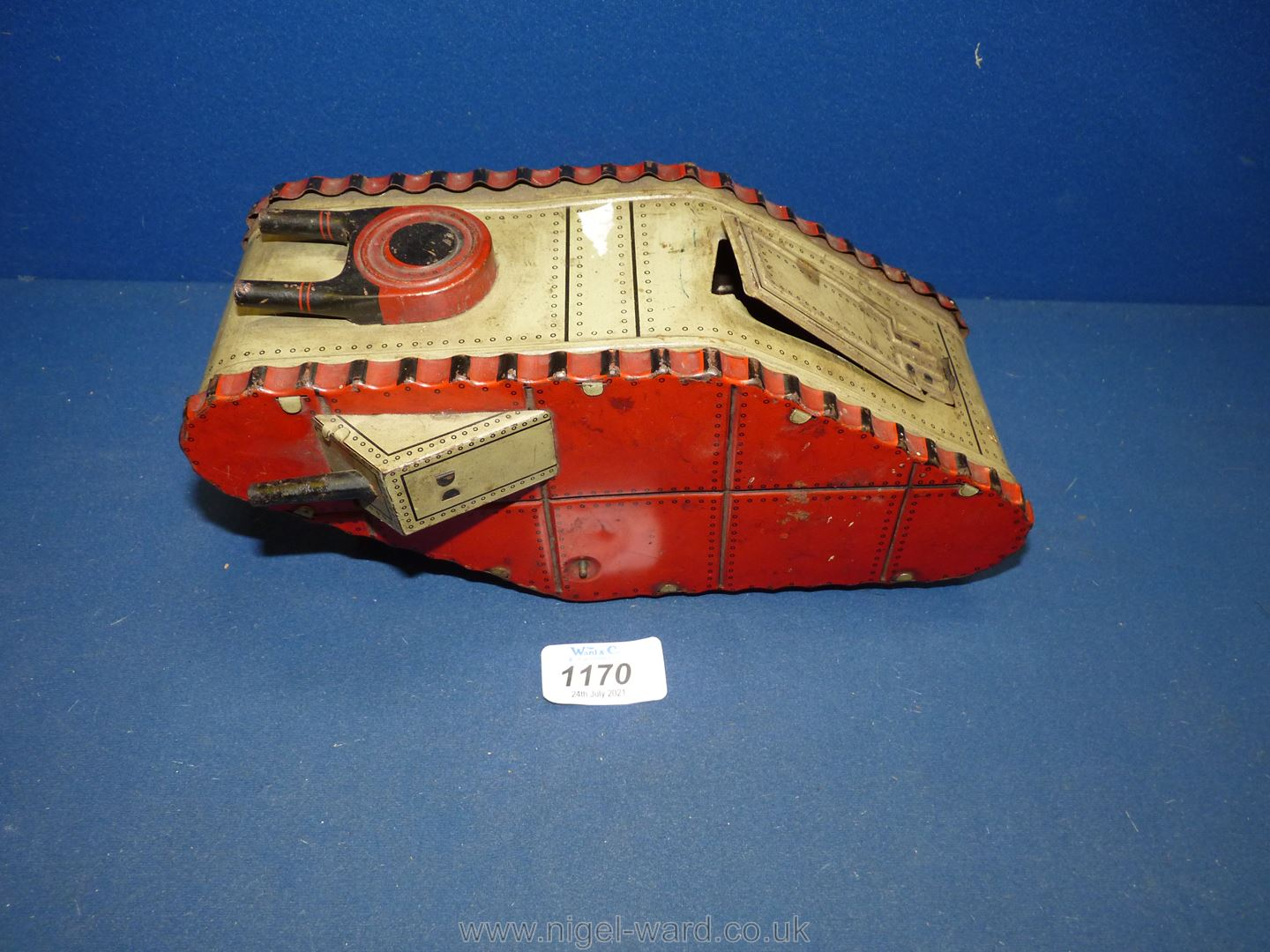 A German made tin plate clockwork toy of a Mark IV-type tank with spring loaded soldier, circa 1925,
