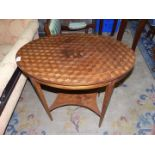 An oval parquetry topped occasional Table standing on lightwood strung tapering square legs united