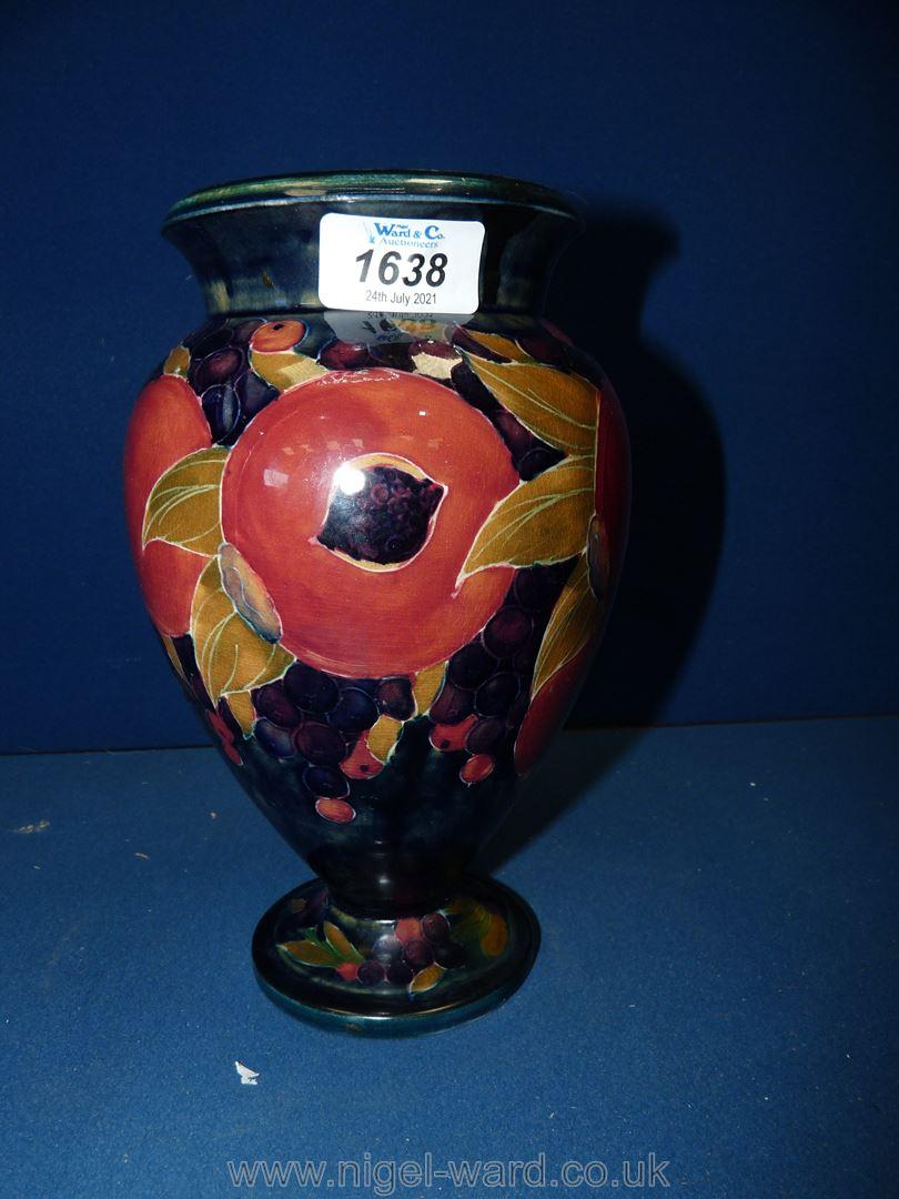 "A vintage Moorcroft vase, pomegranate pattern, 1918 to the base, 9"" tall."
