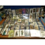 A quantity of early 1900 postcards, hand coloured (in plastic sleeve).
