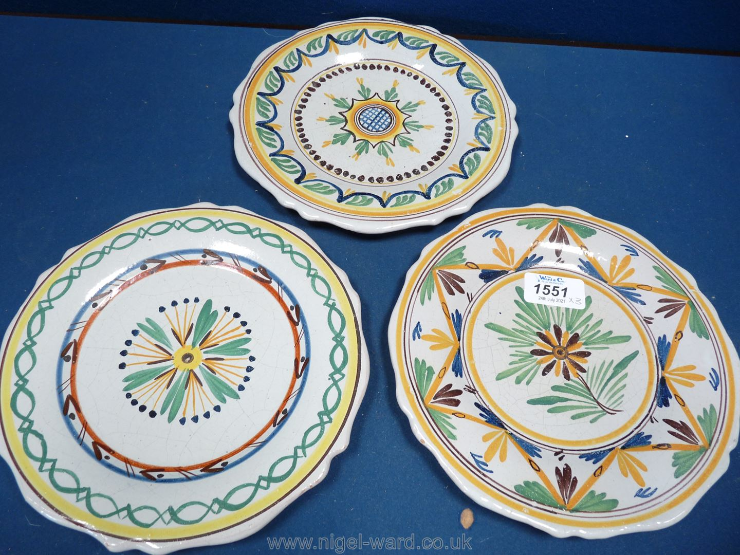 Three early 19th Century French faience plates decorated with flowers and stylised motifs,