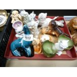 A quantity of dog and cat figures, a glass Sausage Dog, Poole Seal , Royal Copenhagen etc.