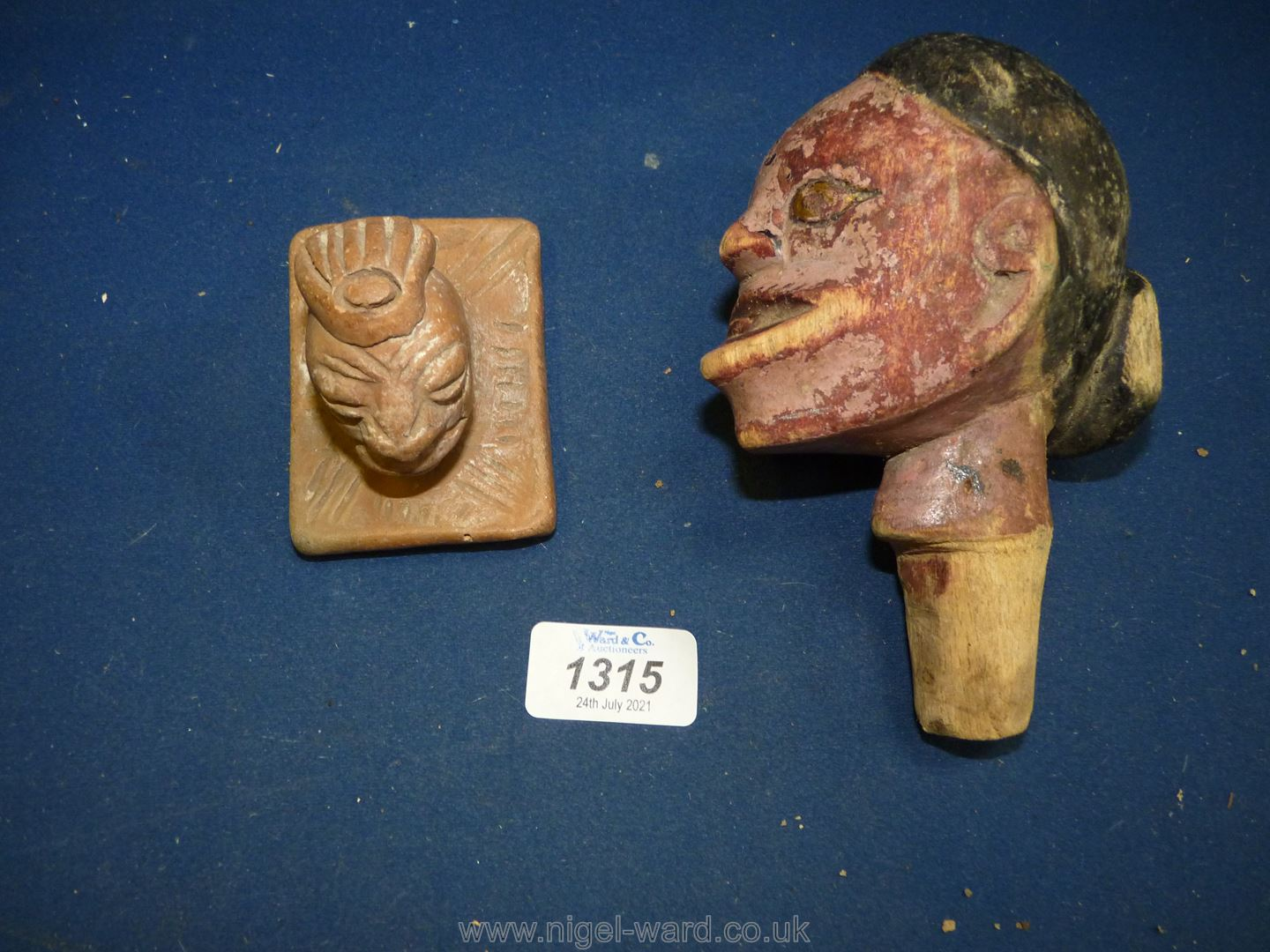 An unusual South American carved wood shamanistic head,