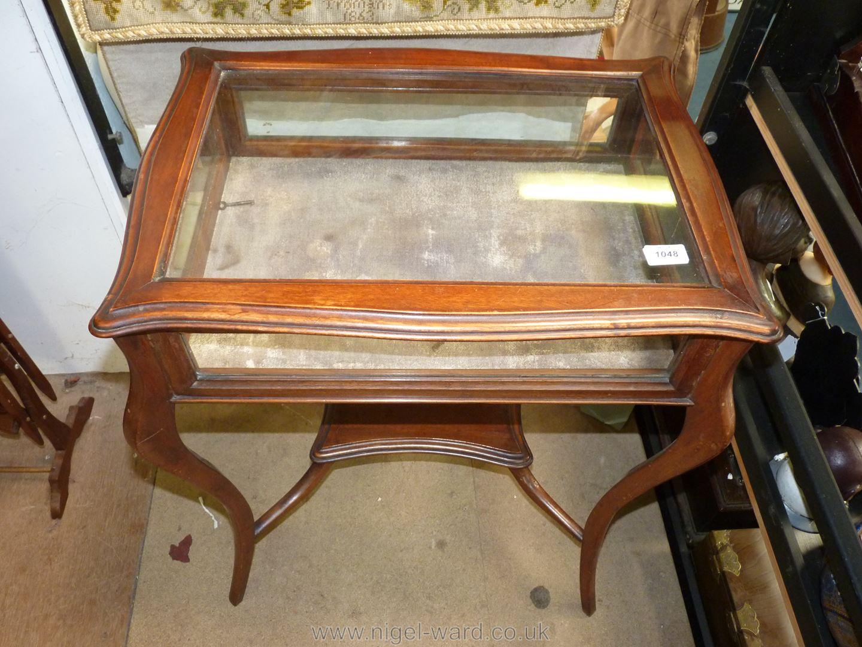 An Edwardian Curio table, 29 1/2'' high x 24'' wide x 17'' deep, with key.