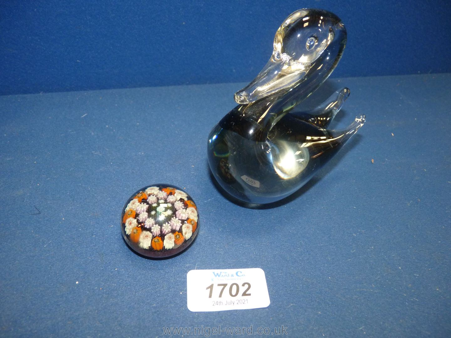 A small Murano glass duck shaped paperweight in smoky grey shade, with mark to base.