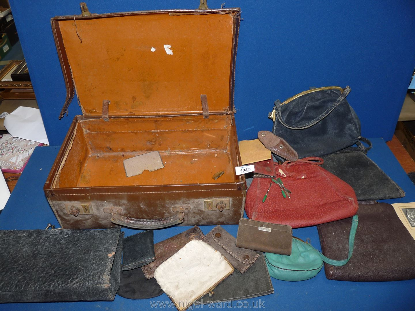 A vintage case of bags and purses