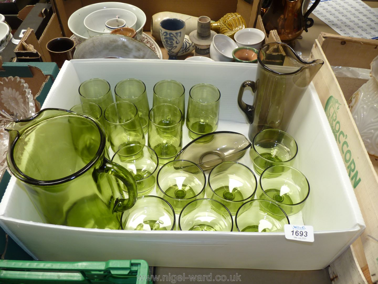 A green glass Lemonade set with five glasses and eight matching sundae dishes plus a smoky coloured