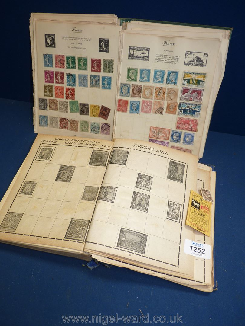 A vintage stamp album, a/f with British Empire stamps of the world and an empty album.