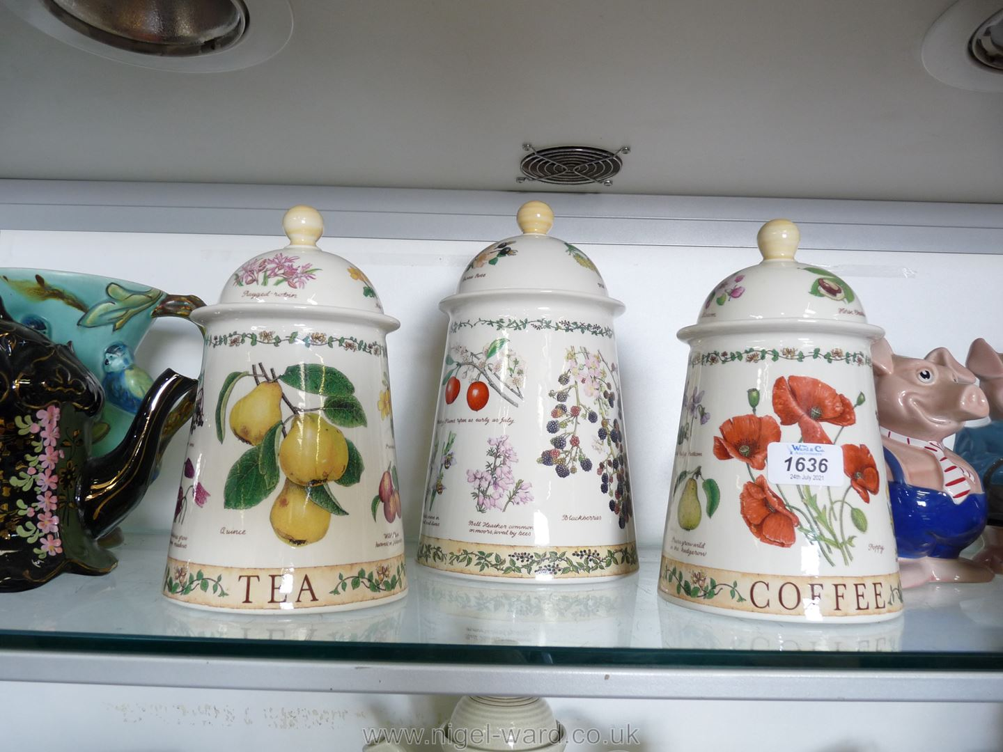 Three pieces of Dunoon stoneware decorated with fruits and flowers: tea, coffee and biscuit jar.