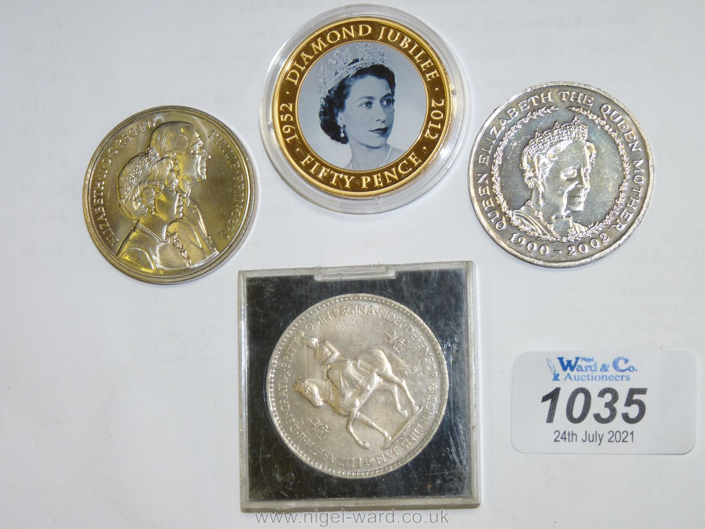 Four commemorative coins including Battle of Waterloo, Prince Regent, Queen Mother five pound coin,