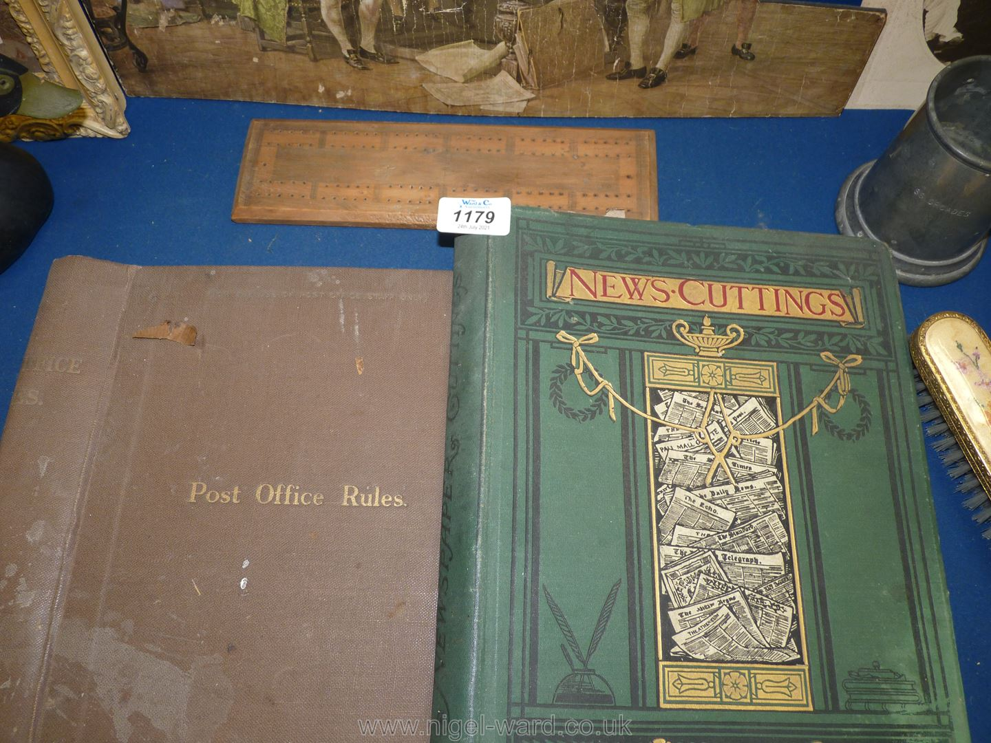 A box of miscellanea including tins, boxes, old documents, original pen and ink cartoon, tankard, - Image 2 of 3