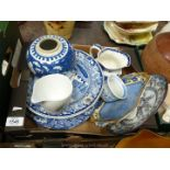 A quantity of blue and white china including willow pattern warming plate (repaired), ginger jar,