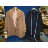 A camel coloured pure wool coat by English Lady and a Damart raincoat.