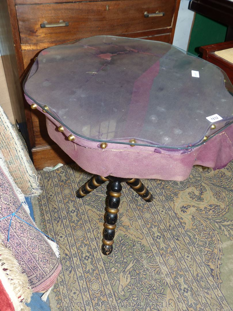 An arts and crafts eight sided Gypsy style Table having turned black and gold finished legs,