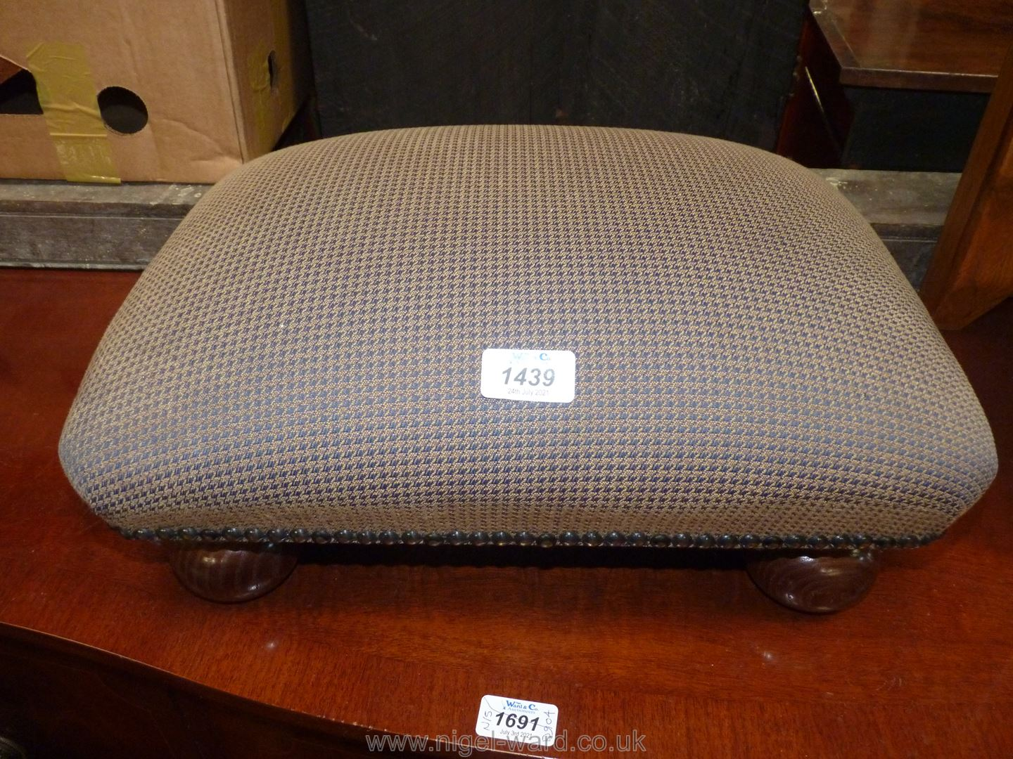 A houndstooth pattern upholstered low Stool on bulbous/bun feet,