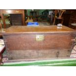 An old darkwood travel Chest having brass lock plate of rope carrying handles to either side,