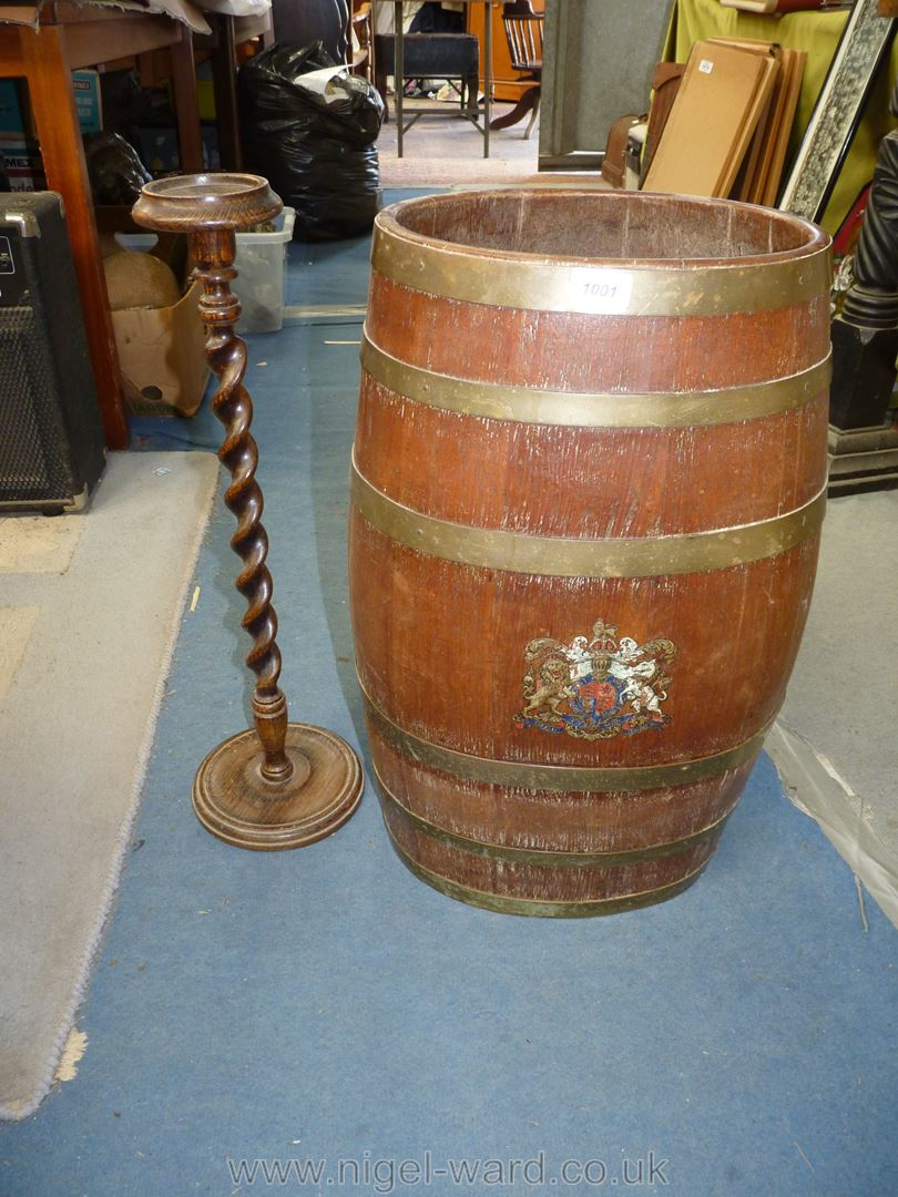 An ovoid coppered Barrel with coat of arms to front,
