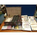 Three albums of first day covers and a quantity of loose first day covers in a case.