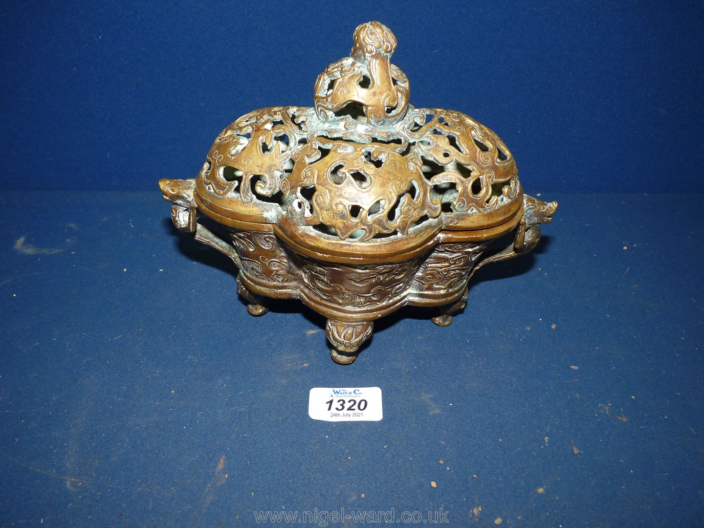 An old but otherwise undated Chinese pierced bronze censer,