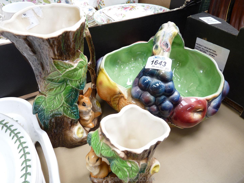 A Sylvac basket fruit bowl together with Hornsea rabbit vases.