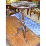 A dark Mahogany wine Table with twist knop and three splay feet.