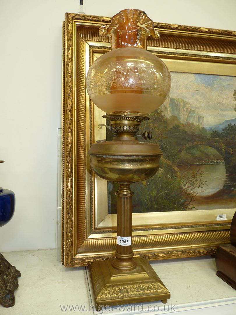 A brass oil Lamp with Corinthian column base, brass reservoir, amber fluted and etched shade,
