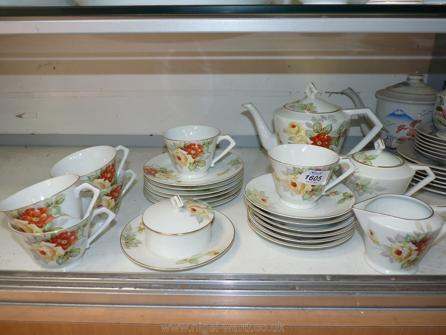 A Noritake tea service with orange and yellow flower pattern including six cups and saucers,