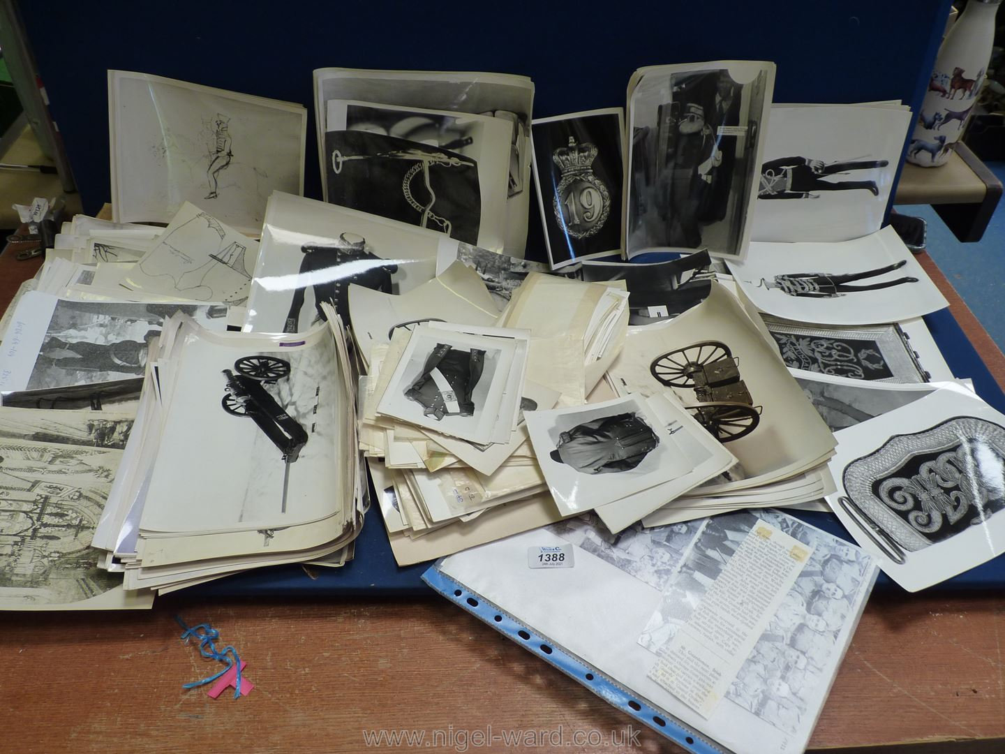 A quantity of black and white reproduction military photographs mostly of uniforms and military