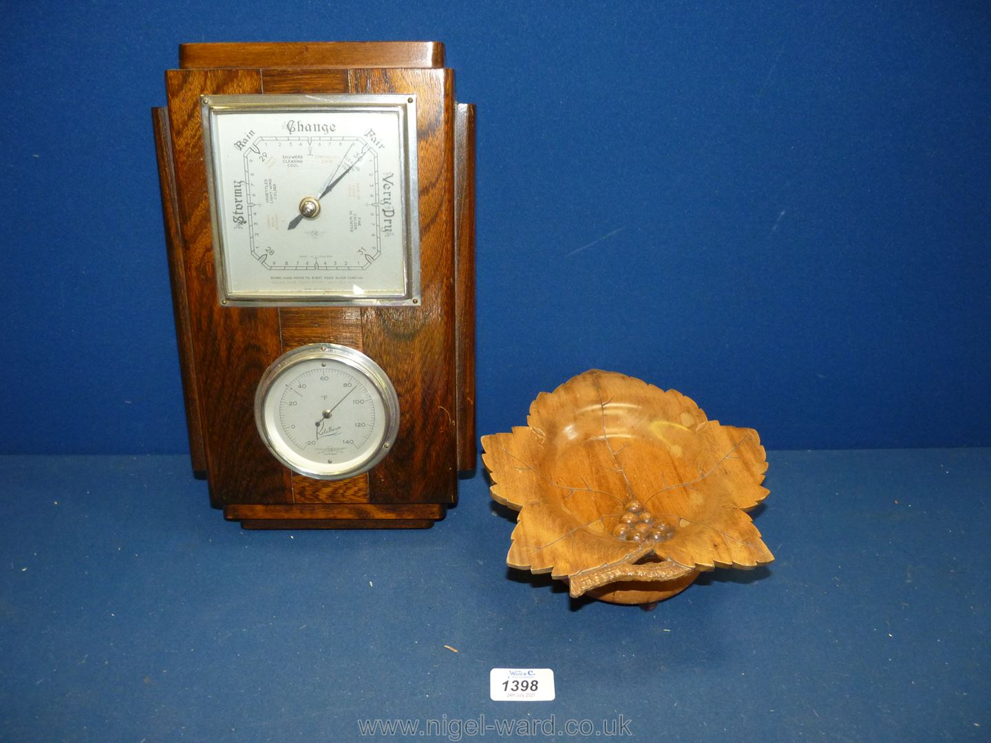 A wooden framed wall barometer/thermometer and a treen musical sweet plate. - Image 2 of 2