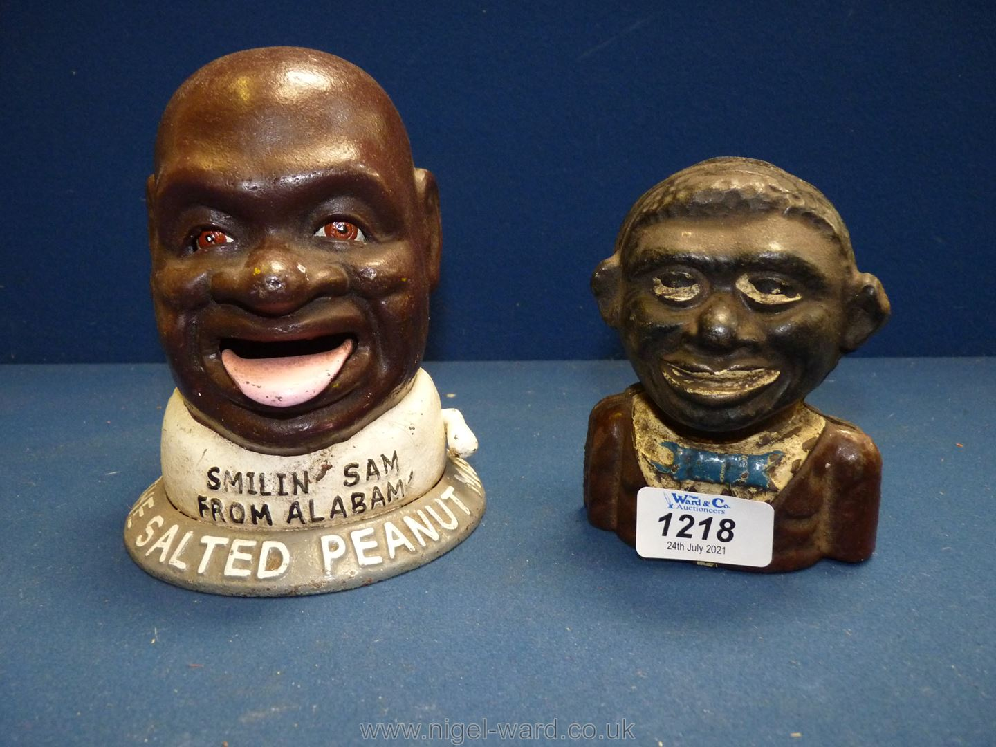 """Two cast iron Money Banks including """"Smiling Sam from Alabama""""."""