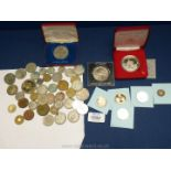 A quantity of commemorative coins and crowns plus other coins.