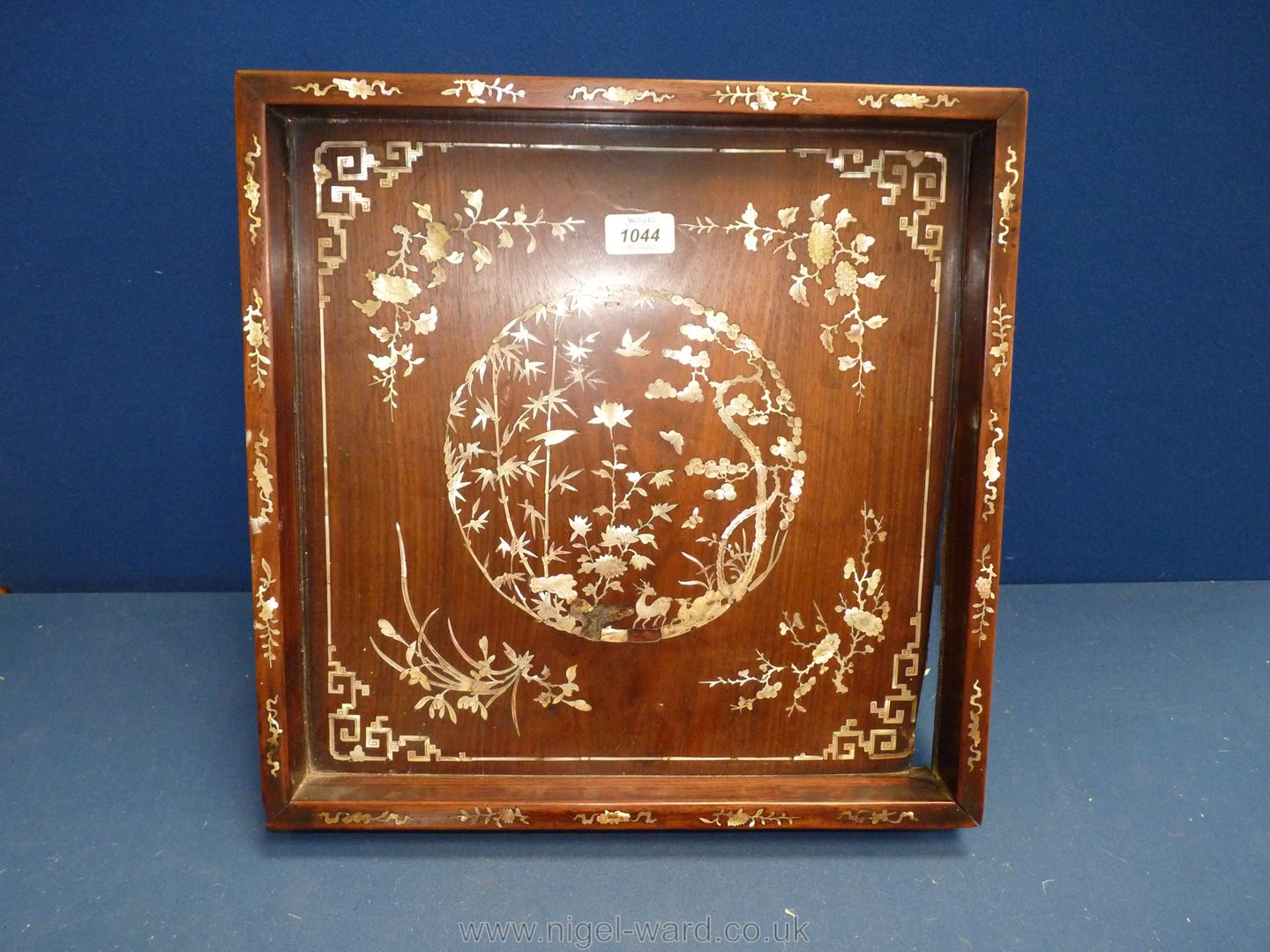 A Chinese wooden Tray profusely decorated with Mother of Pearl inlay depicting flowers, etc.