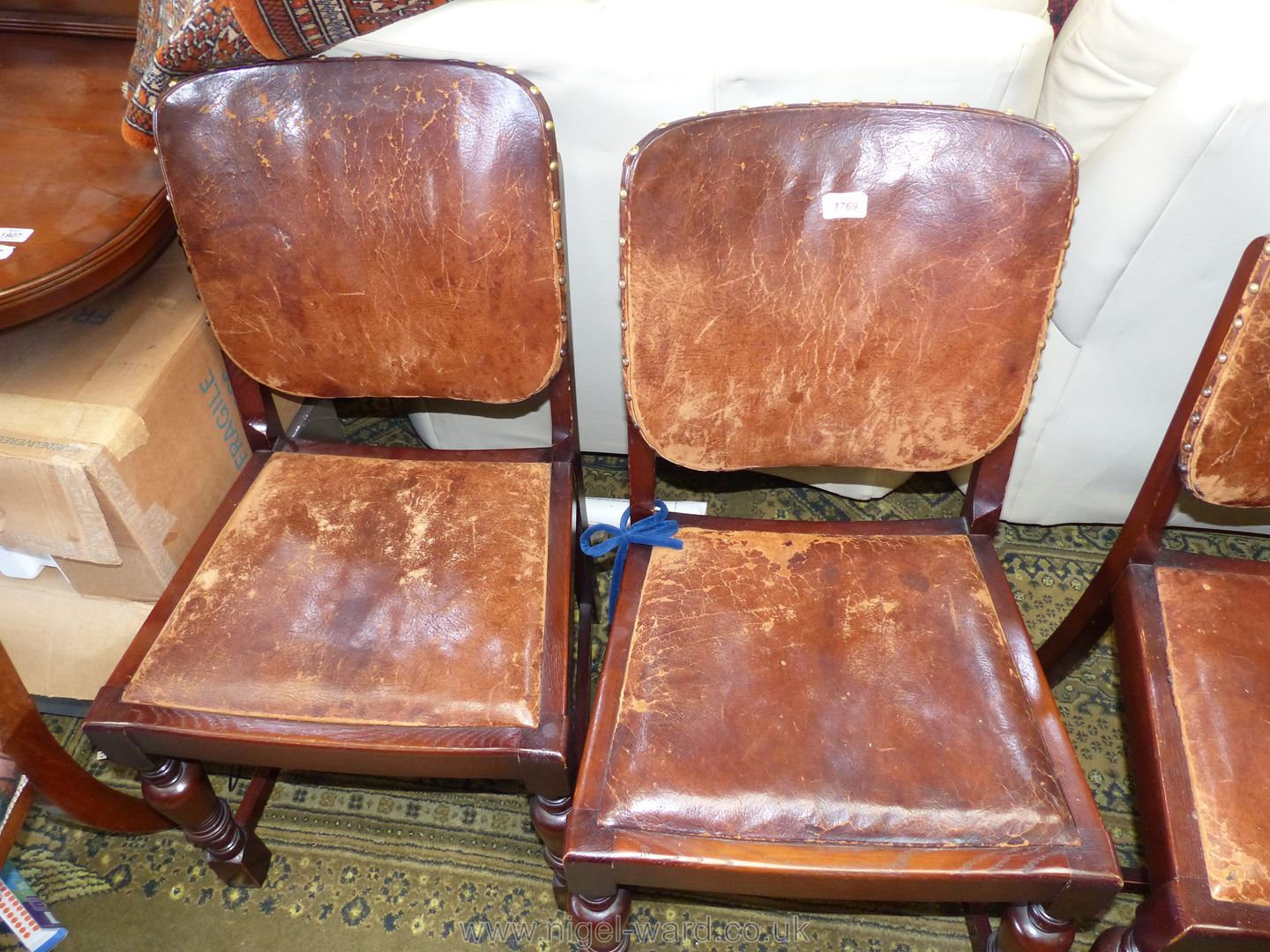 A set of four Oak framed Dining Chairs having brown hide upholstered backs and drop-in seats. - Image 3 of 5