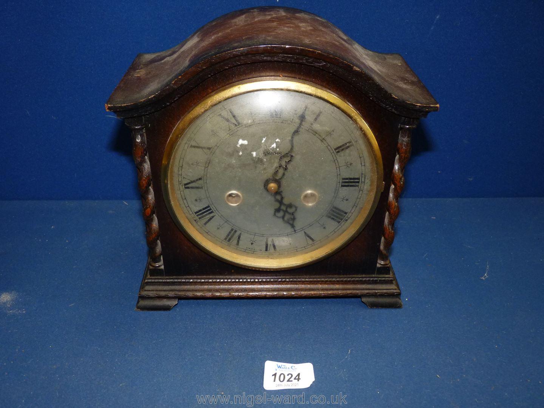 A Smiths Enfield mantle Clock with twist columns, pendulum present,