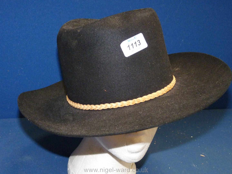 An Akurba pure fur cattleman Hat, size 7 1/8.