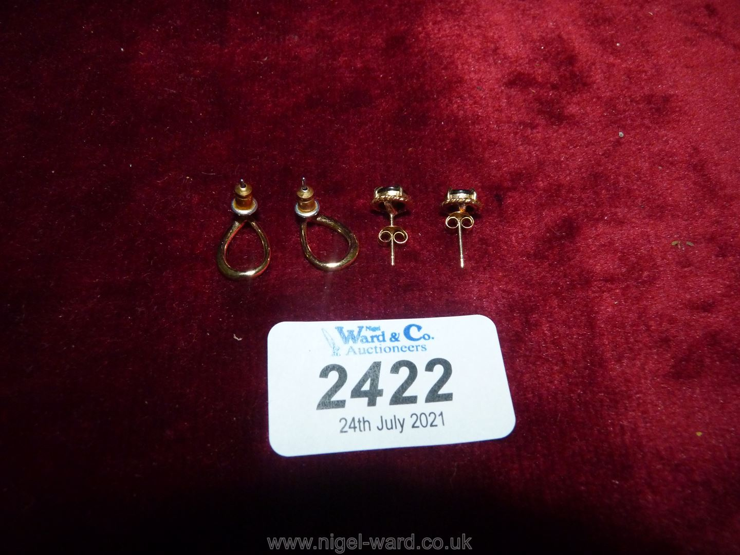 Two pairs of yellow metal ear-rings one set with red stone the other with white chips. - Image 2 of 2