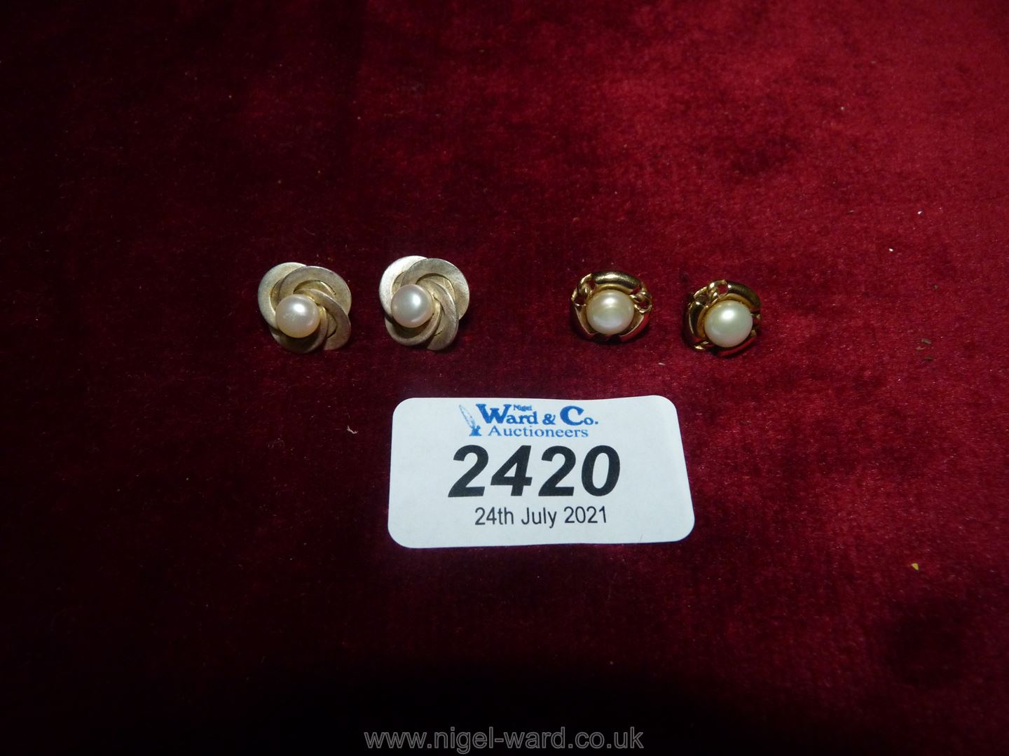 Two pairs of pearl earrings one pair set in silver the other 9ct gold.