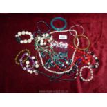 A quantity of costume jewellery to include; beaded bangles, necklaces, butterfly brooches, etc.
