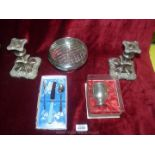 A pair of silver plated dumpy candlesticks, a rose bowl,