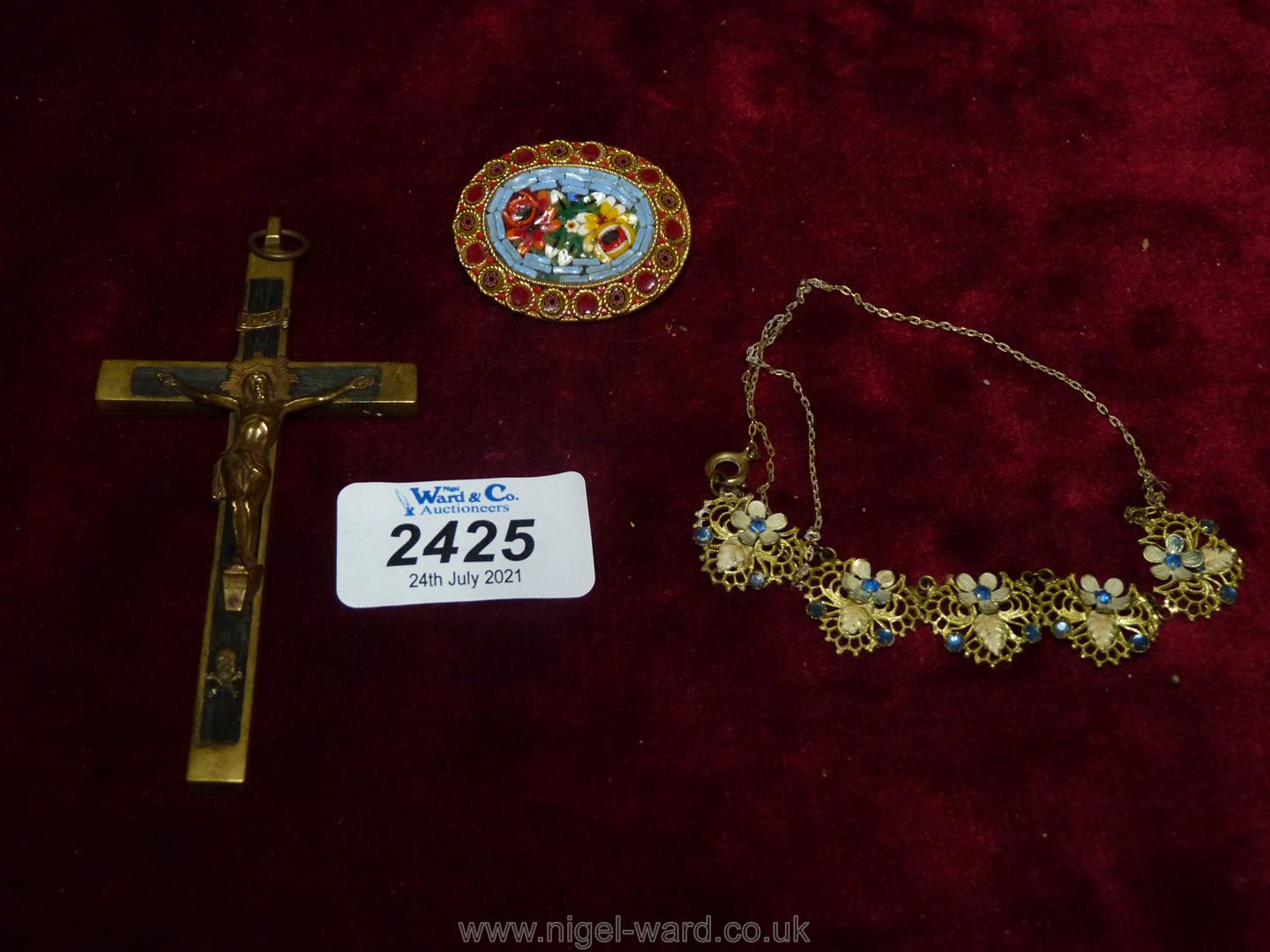A large brass crucifix, micro mosaic brooch and pretty yellow metal and blue stone necklace.