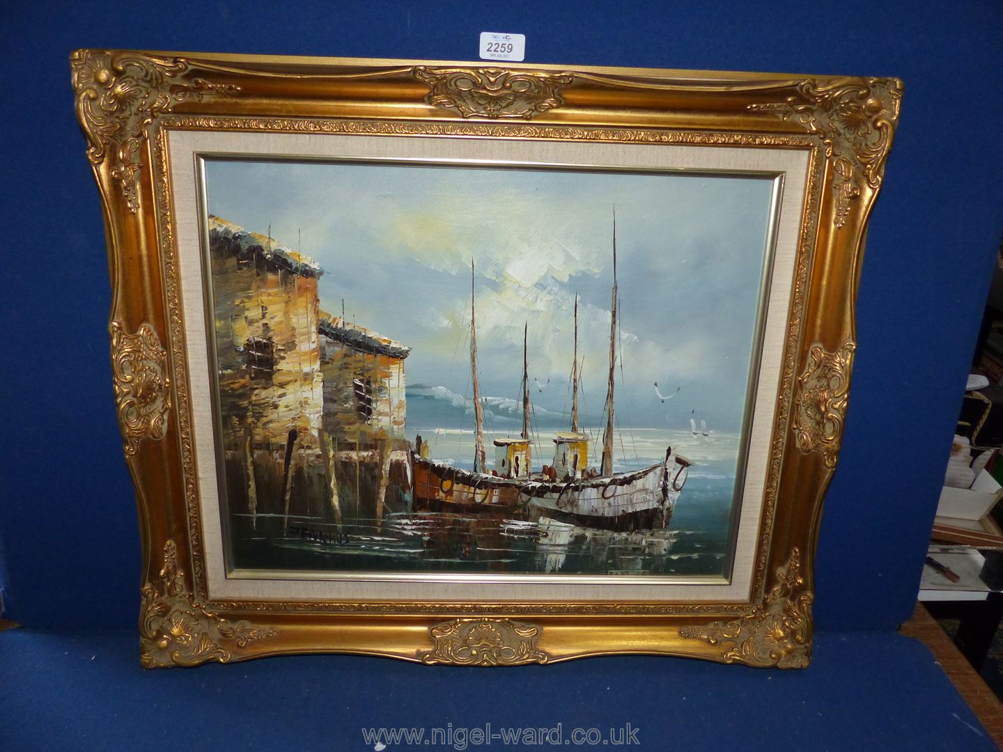 A gilt framed Oil on canvas of a boat, signed J.