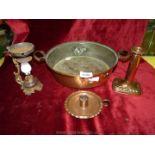 A copper pan, chamberstick, etc.