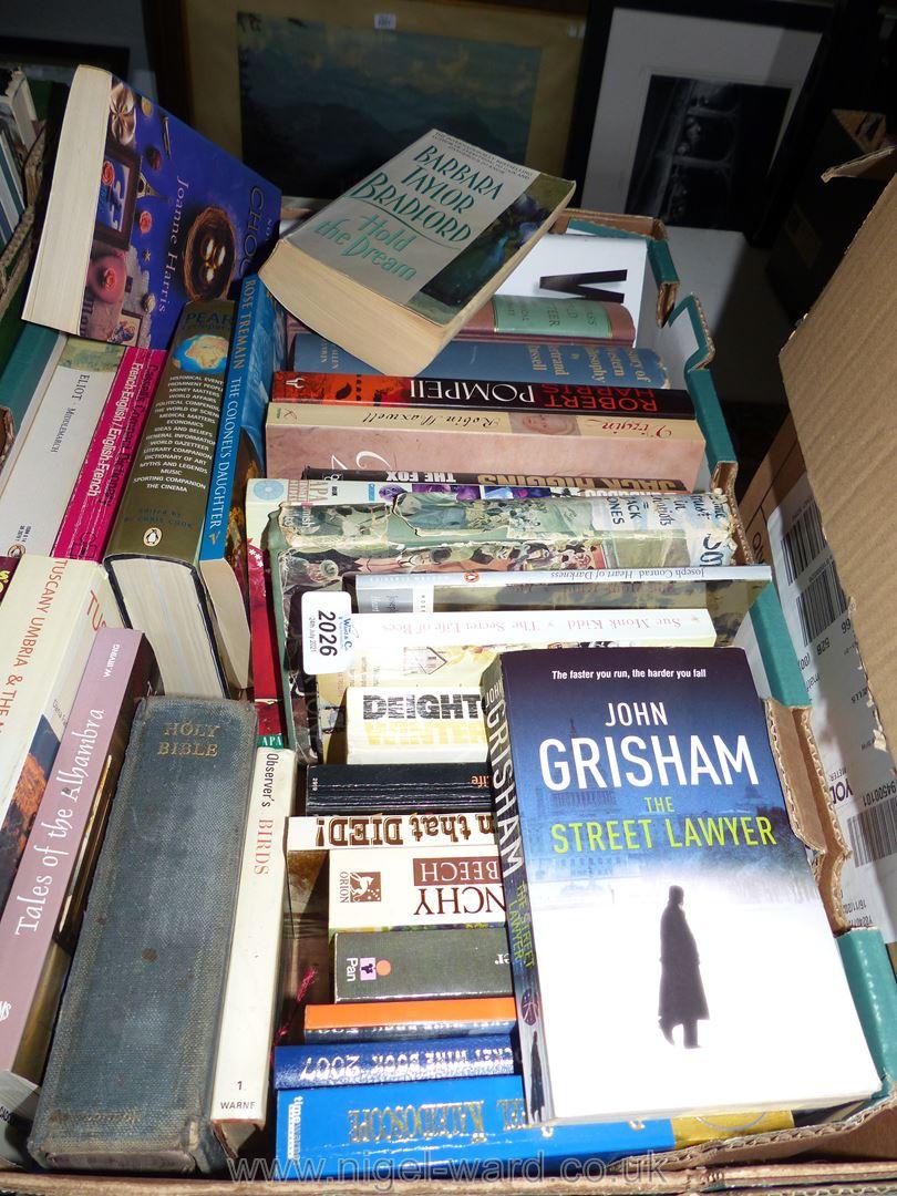 A box of novels, John Grisham, Maeve Binchy etc.