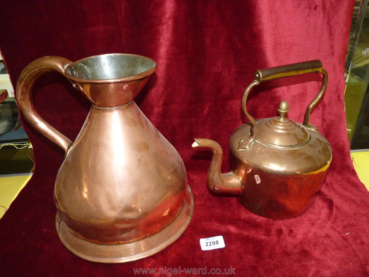 A large Copper Jug and a copper Kettle.