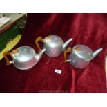 Three Picquotware teapots.