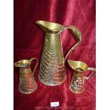 Three brass jugs,