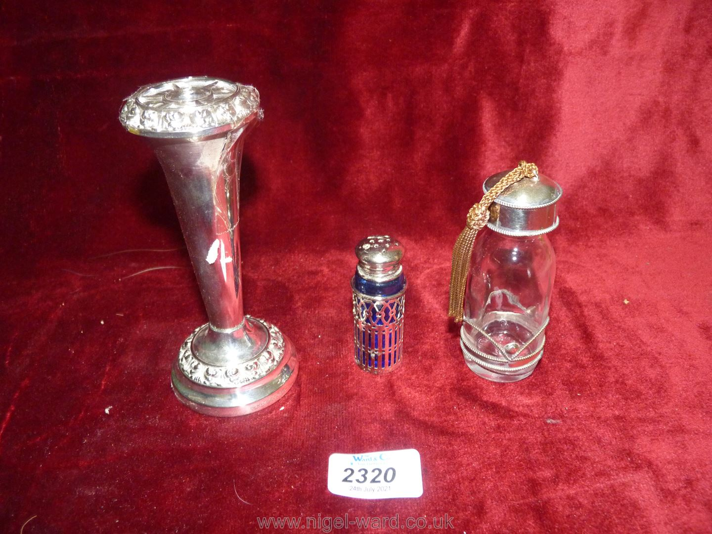 Three small pieces of white metal and plate including bud vase with loose stem and insert,