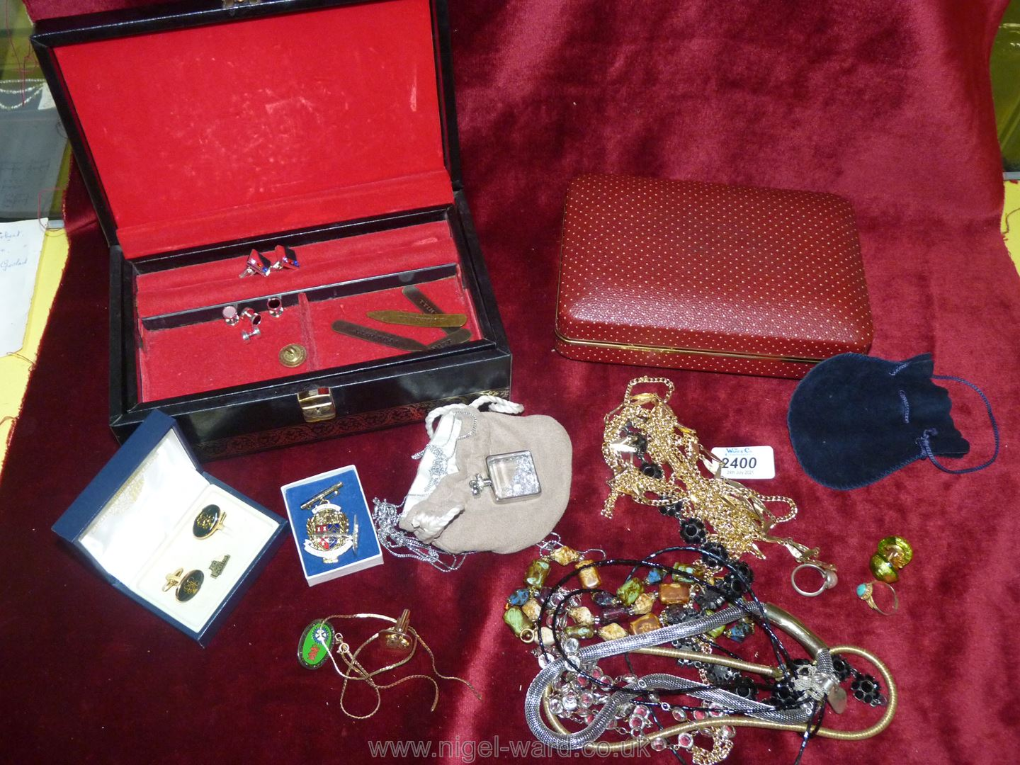 Two boxes of costume jewellery including a black jewellery box with red velvet interior, cuff links,
