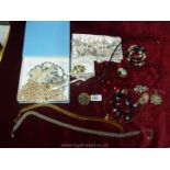 Two boxes of costume jewellery to include a pearl choker, brooches, necklaces, 'Monaco' brooch etc.